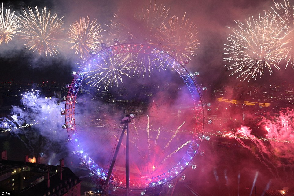 Fireworks light up the sky over the London Eye in central London during the New Year celebrations on the stroke of midnight