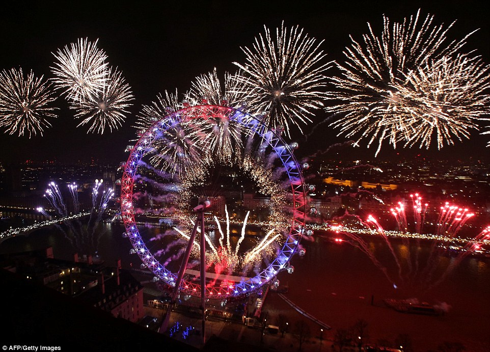 Fireworks explode around The Elizabeth Tower, also known as 'Big Ben', and the London Eye during New Year's celebrations in central London just after midnight on January 1, 2017