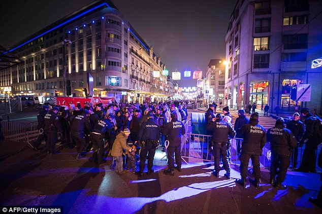 Brussels: Revellers queue to get in the De Brouckere square for the fireworks performance as Belgium's police officers conduct searches