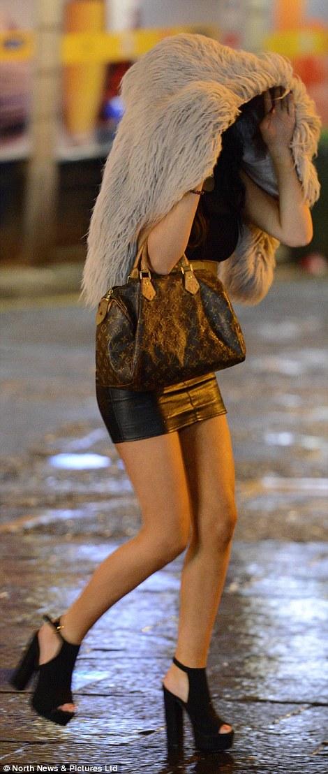 A woman celebrated in a mini skirt despite the heavy rain