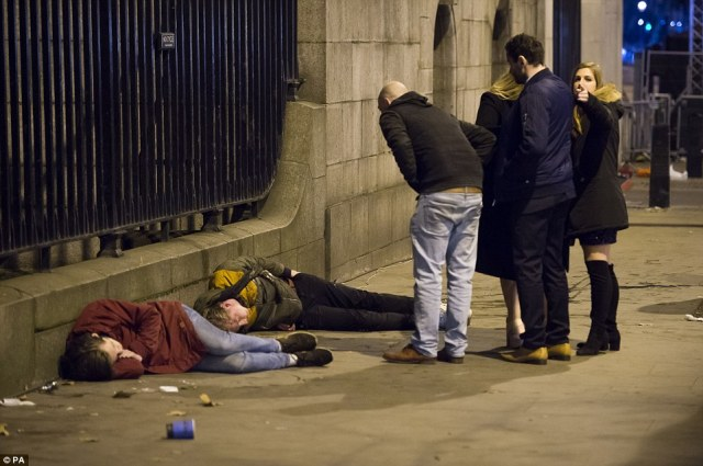 Two men were seen lying slumped on the ground in Albert Embankment, central London, as the excitement proved too much