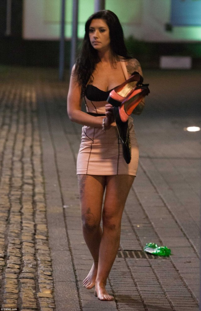 A girl walks barefoot through the streets of Bristol after bringing in the New Year in the West Country