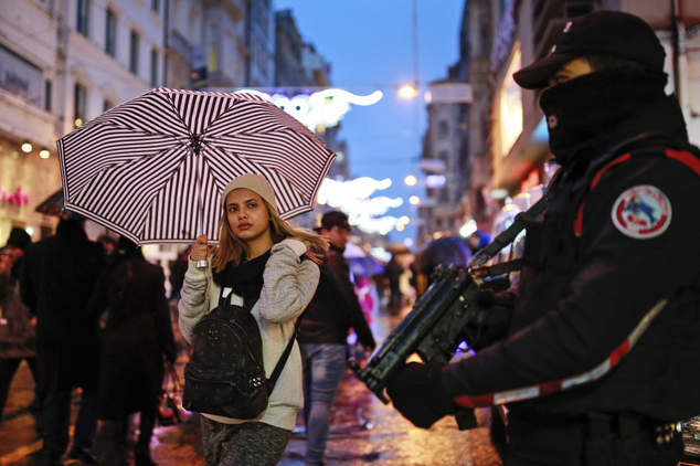 Turkish police provide security in central Istanbul's Istiklal Avenue, the main shopping road of Istanbul, on New Year's Eve, Saturday, Dec. 31, 2016. (AP Ph...