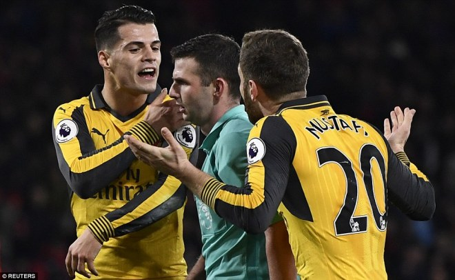 Xhaka pictured arguing with referee Oliver, who gave Bournemouth a penalty and the chance to double their lead