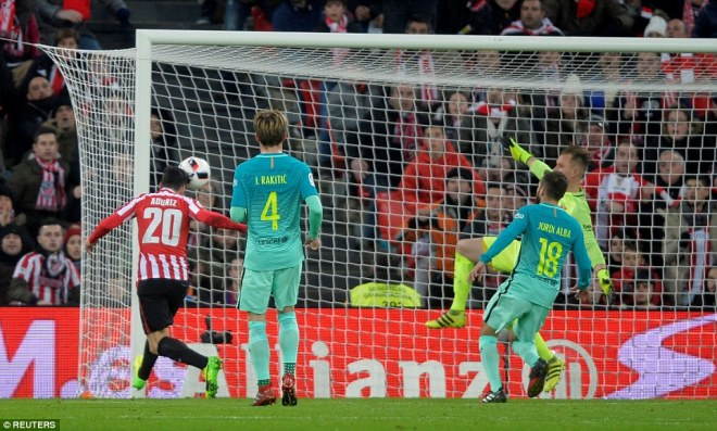 Aritz Aduriz meets a cross at the far post to head Athletic Bilbao into a 1-0 lead at the San Mames against Barcelona
