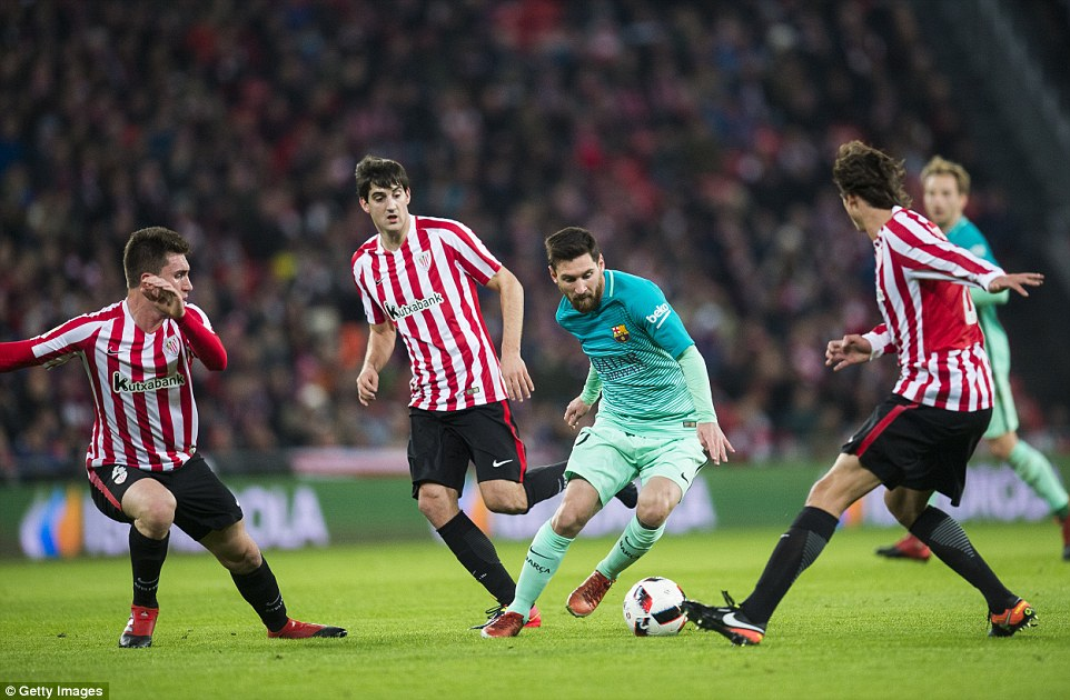 Messi weaves his way past a trio of Athletic Bilbao defenders as he attempts to drag his side back into the fixture