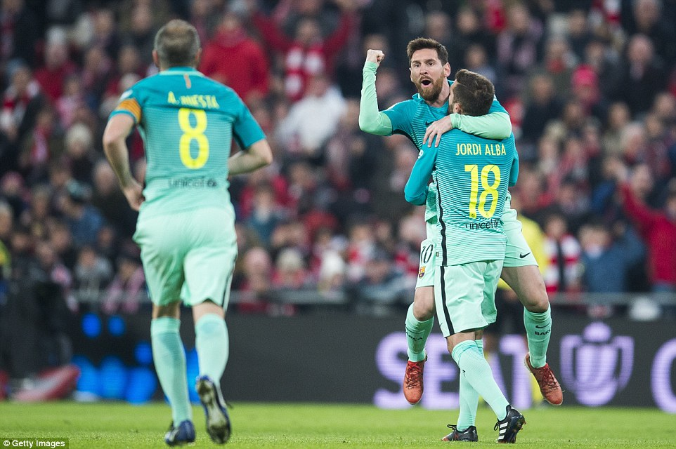 The Argentine pumps his fist as he lofted up into the Bilbao night air by Jordi Alba after reducing the deficit to just one goal