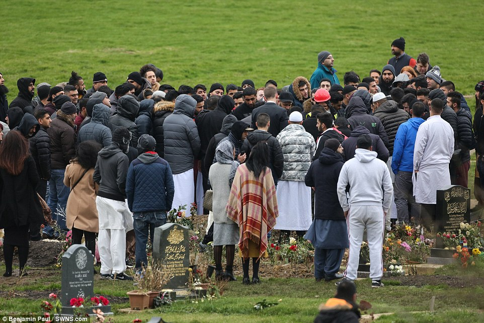 Packed: A huge crowd surrounded Yassar's grave today as an inquest heard that he died from gunshot wounds to the chest