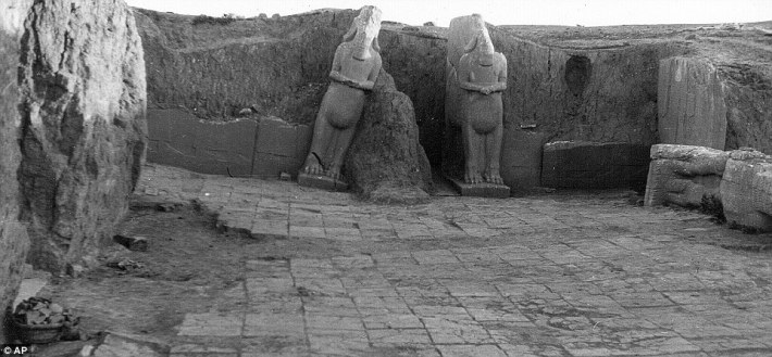 This Christie image shows two the two Assyrian winged bull deities of Iamassu from the front leading to the palace entrance