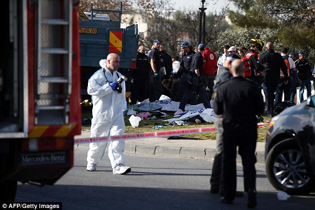 The killer drove his truck at the victims and then reversed over them when he was shot dead