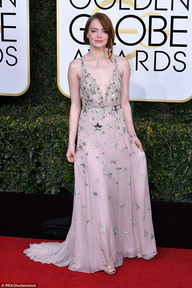 Every year, we debate over contributing our true top picks and making sure that we don't have any repeats because there are plenty of gorgeous gowns to go around. And just about every year, we end up with one gown that neither of us can, in good conscience, leave off of our list. This time it's Emma Stone, a city of stars unto herself. I love the soft champagne color, the crenelated skirt (so 20s and 30s! so perfect for this role, in particular), and the understated hair, makeup and jewelry. Emma almost always makes our best list, and I'm thrilled she'll be on every red carpet this year because I think she's positively refreshing, both in her exquisite fashion picks and in her laid-back but kind personality.