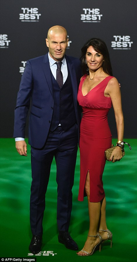Real Madrid manager Zinedine Zidane, in a navy suit, with his wifeVeronique, who chose a red dress for the event