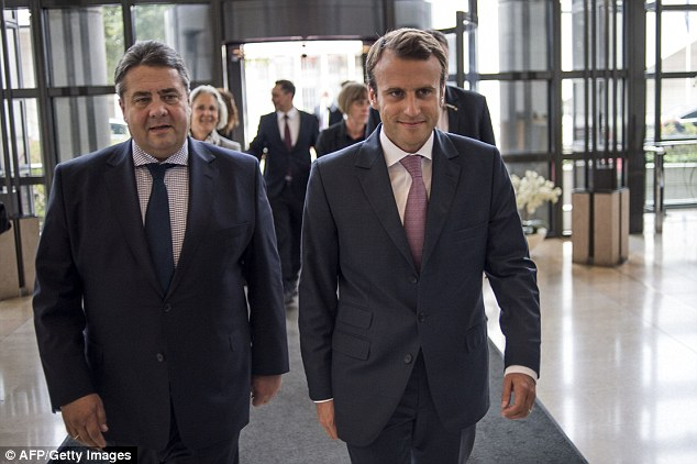 The maverick: Emmanuel Macron (pictured, right, with Germany's Economy Minister Sigmar Gabriel) is aiming to become the first independent to be elected France's President since 1920