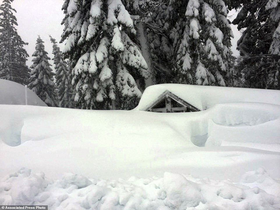 Several ski resorts in parts of the Sierra Nevada planned to stay shuttered Wednesday, including Squaw Valley and Alpine Meadows, which had no power because of the storm. The Siig's home is pictured from the outside buried in snow