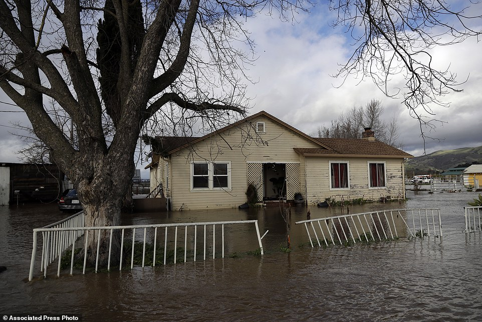 The series of storms has also added 39 billion gallons of water to Lake Tahoe since January 1. Stormy weather extended north where Portland, Oregon and Southwest Washington were slammed with a surprising foot of snow, unusual for an area that normally sees rain. A flooded home is seen along Lovers Lane in Hollister, California
