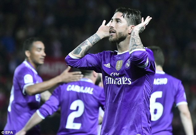 Sergio Ramos cupped his ears to the Sevilla fans after scoring a penalty in Real Madrid's game
