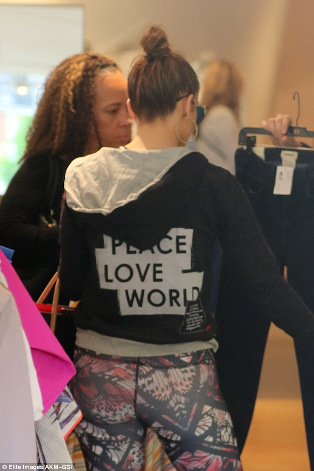 Word up: The Selena actress wore a graphic sweatshirt with the words 'Peace, love, world' written on the back