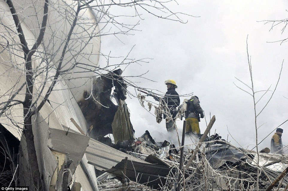 Up to 43 homes were crushed by the jet as it ploughed along the ground for 'hundreds of yards', destroying houses and wiping out entire families sleeping inside
