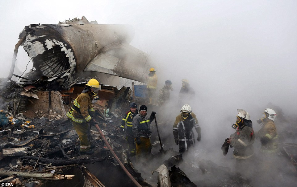 Buildings were still on fire when rescuers reached the scene this morning. At least 37 people were killed in the disaster
