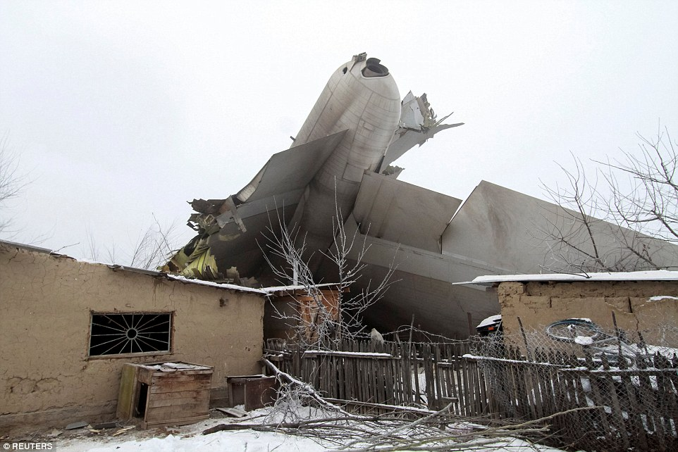 Dramatic pictures at the scene show the plan upside down after crashing through dozens of buildings in the village