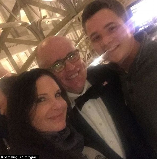 Cybersecurity expert for the Trump White House, Rudy Giuliani, is seen with two people at the Trump International Hotel in DC on Wednesday night