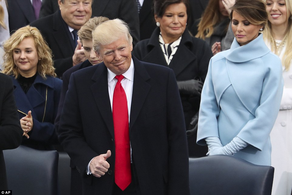 President-elect Donald Trump flashes a thumbs up during the 58th Presidential Inauguration at the U.S. Capitol in Washington, Friday, Jan. 20, 2017