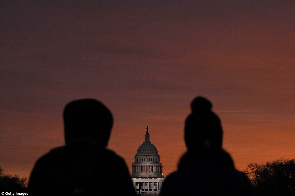 WASHINGTON, DC - JANUARY 20: People gather on the National Mall prior to Donald Trump's Presidential Inauguration on January 20, 2017 in Washington, DC. Trump is being sworn in as the 45th President of the United States