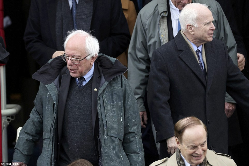 Senator Bernie Sanders, left, who lost the Democratic nomination arrives at the Capitol on Friday. He's pictured next to Arizona Senator John McCain, who ran a failed campaign against President Obama in 2008. McCain has now become a main opponent of Trump, despite being a senior member of the president's party
