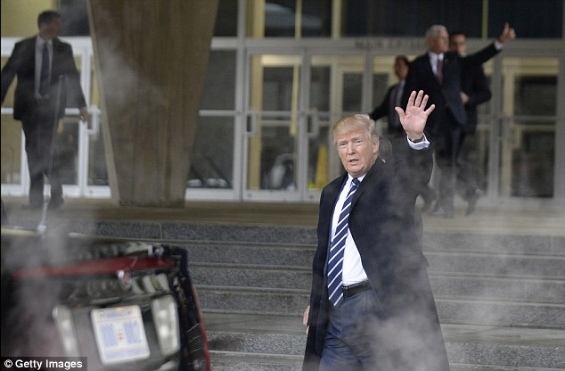 Trump (pictured leaving the CIA) launched his own attack on the 'dishonest' media on Saturday at CIA headquarters