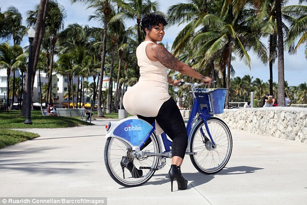 Courtney rides a bike on Miami's Ocean Drive. Courtney, also known as Miss Miami, initially decided to have the illegal silicone injections after working as a dancer whilst studying