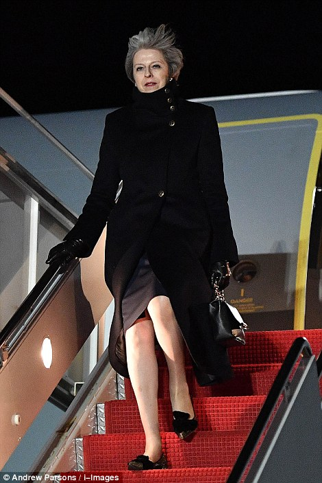Theresa May arrived in Andrews Air Force base outside Washington DC late Thursday US time ahead of Friday's crucial trade talks with President Trump