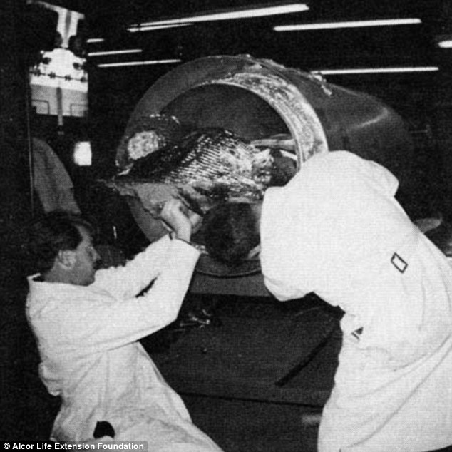 After being placed into the capsule, technicians covered Bedford's feet with heat shielding and bolted the stretcher into place on the side rails