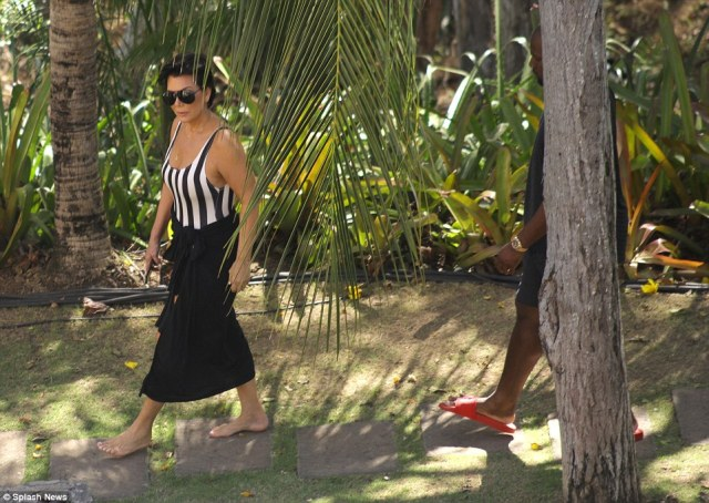 Here comes the momager! Kris Jenner looked trim in black and white as she was followed by beau Corey Gamble