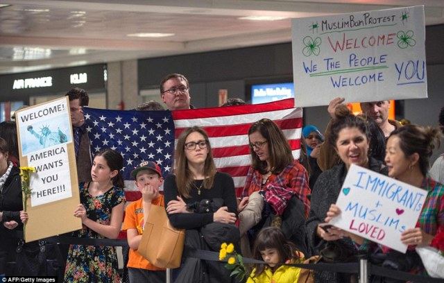 While a protest unfolded at Dulles International airport, Virginia Governor Terry McAuliffe and Attorney General Mark Herring have said the state could take legal action against the ban