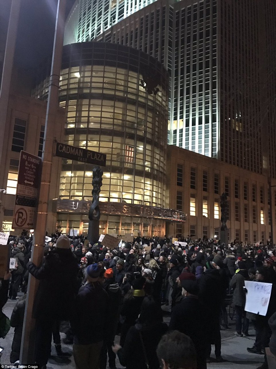 A crowd of protesters gathered on Brooklyn's Cadman Plaza Saturday night, outside of the federal court for the Eastern District of New York that issued the stay