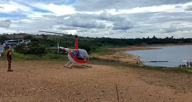 The helicopter prepares for lift off next to Rio Curvo