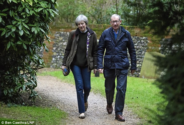 Theresa May, pictured with husband Philip attending church in her Berkshire constituency this morning, flew back into a storm over her response to Donald Trump's controversial ban on people entering the US from seven majority-Muslim countries