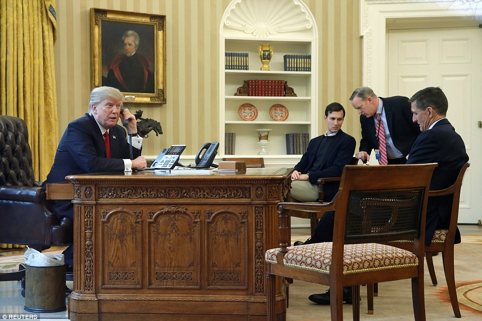 Trump is pictured withJared Kushner, Communications Director Sean Spicer and National Security Advisor Michael Flynn during a call to the Saudi King on Sunday