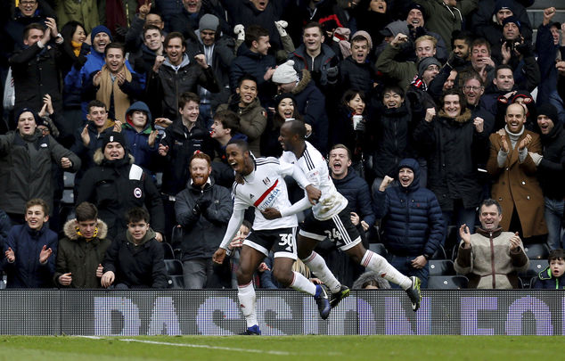 Fulham's Ryan Sessegnon celebrates scoring his side's third goal of the game with Sone Aluko, right, during the English FA Cup, Fourth Round match, Fulham vs...