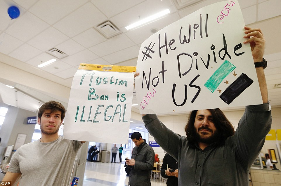 'He will not divide us': One demonstrator made a plea for unity at Dallas Fort Worth Airport while protesting with his brother