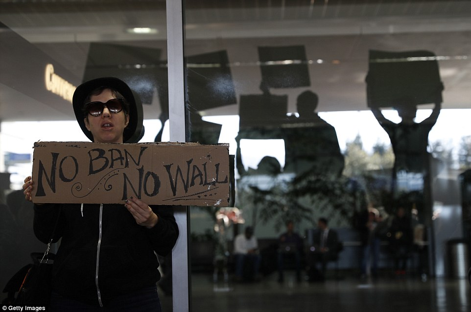 'No ban, no wall': One demonstrator spoke out against two of Trump's major campaign promises at the San Francisco rally