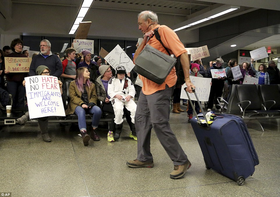 Travelers arriving to at the international gate of the Minneapolis-St. Paul International Airport were greeted by protesters demonstrating against the executive order signed by President Trump