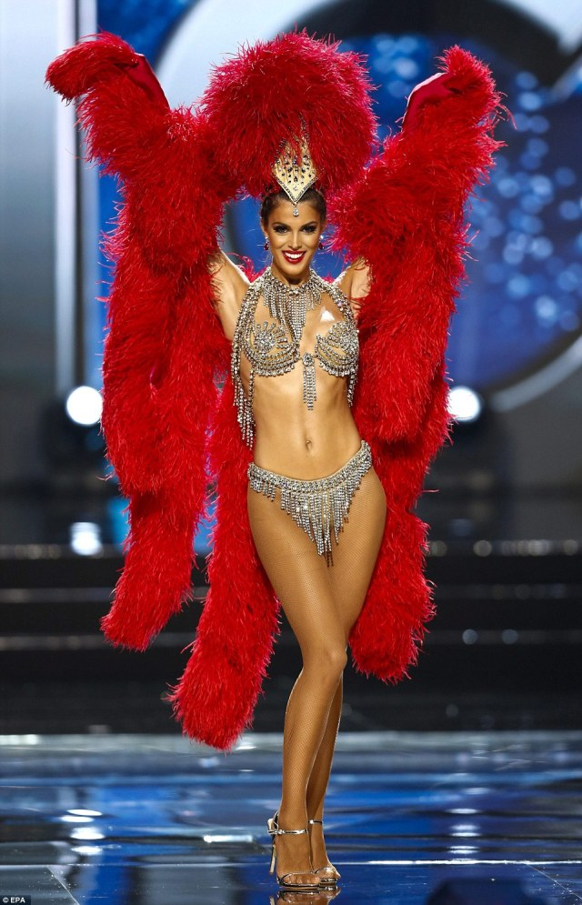 Mittenaere is pictured during the pageant in her national costume - a cabaret-inspired ensemble with red feathers