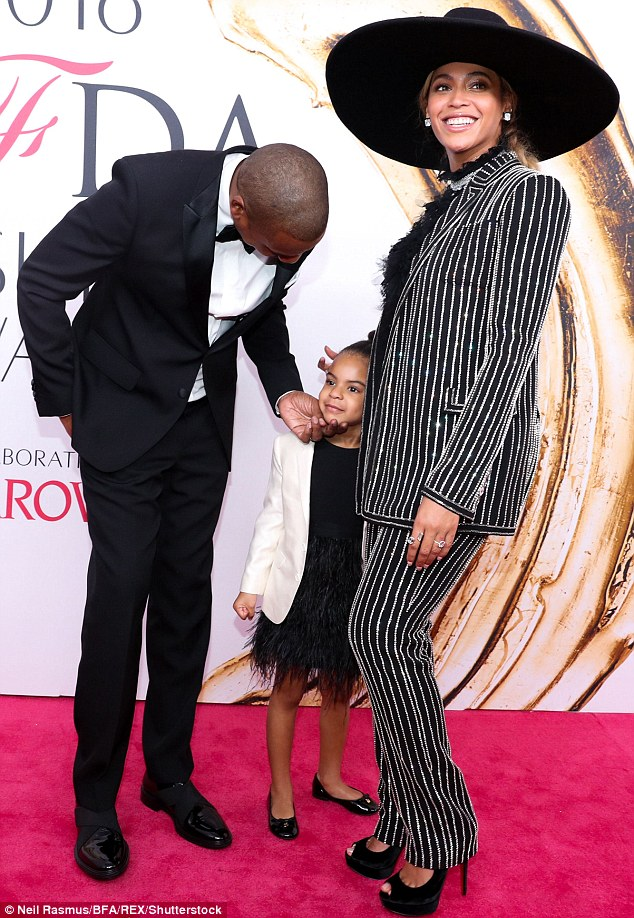Doting parents: The couple with the five-year-old daughter Blue Ivy in June