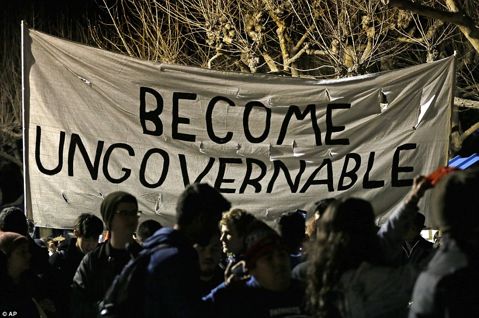 Demonstrators held up banners which read 'Become ungovernable' at the UC Berkeley protest