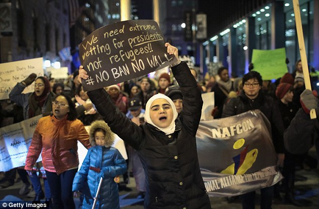 President Trump's controversial 'Muslim ban' has sparked protests across the US, including this one in Chicago, and across the globe