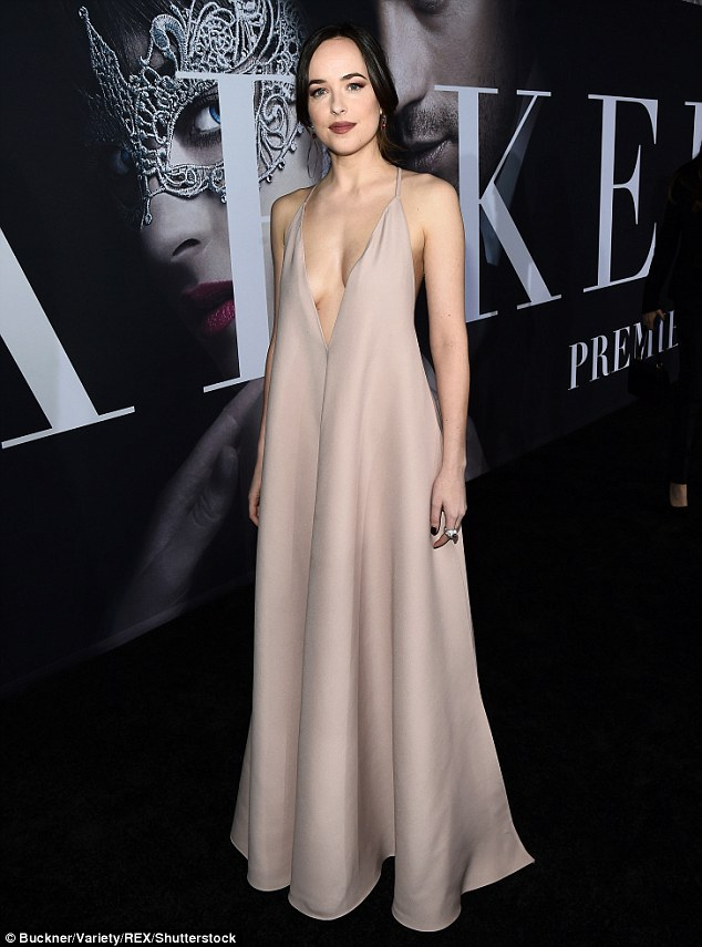 Dressed for the occasion: Dakota Johnson arrived to the Los Angeles premiere of Fifty Shades Darker in a revealing but elegant dress on Thursday night