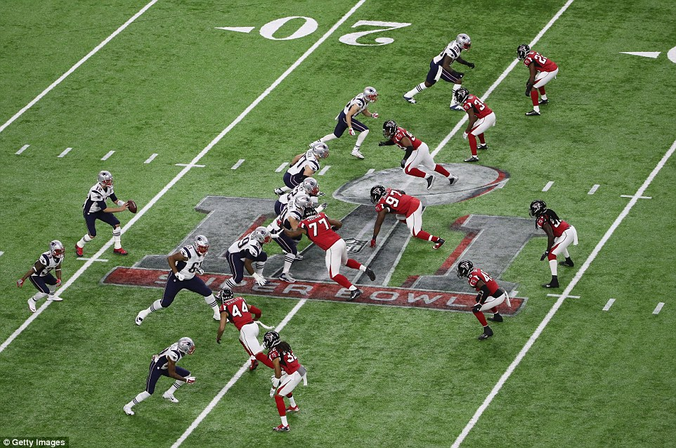 Battle lines: Tom Brady of the New England Patriots takes the snap in the first quarter against the Atlanta Falcons during Super Bowl 51