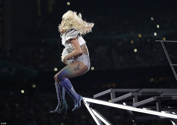 Lady Gaga dropped from the top of Houston's NRG Stadium to open her halftime show and dropped the mic at the end, offering a program that delivered high-energy hits and an inclusive theme