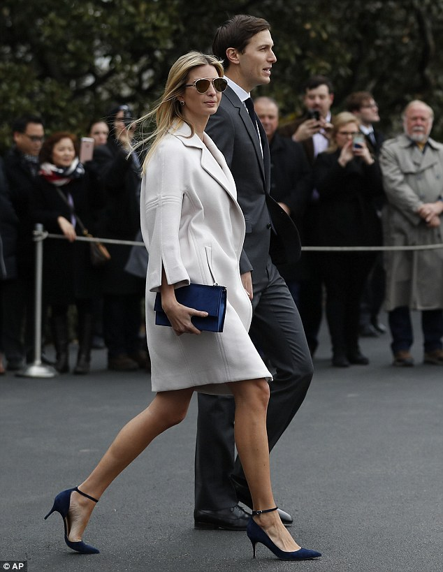 Ivanka Trump wears her own label's shoes and purse as she walks alongside her husband, Senior White House Advisor Jared Kushner, from the White House to join President Donald Trump and Japanese Prime Minister Shinzo Abe on Marine One in Washington